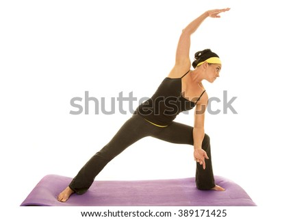 a woman doing her yoga stretching out her back and legs. - stock photo