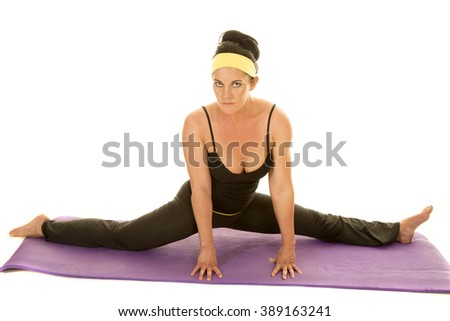 a woman doing the splits stretching out her body. - stock photo