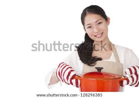 A woman dressed in apron with a pot - stock photo