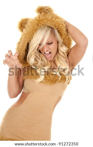 A woman dressed like a lion with her hand like claws. - stock photo