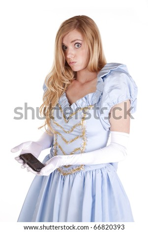 A woman dressed like Cinderella is holding a cell phone wondering what to do with it. - stock photo