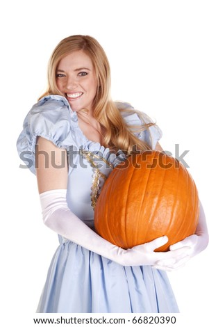 A woman dressed like Cinderella is holding a pumpkin. - stock photo