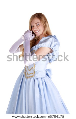 a woman dressed up in her princess dress with a huge smile on her face. - stock photo