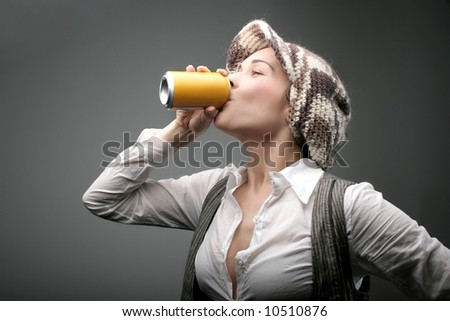 a woman drinking by aluminum - stock photo