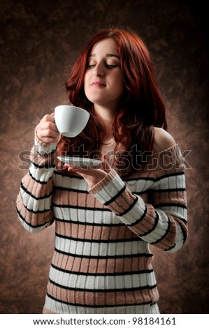 a woman drinks her coffee - stock photo