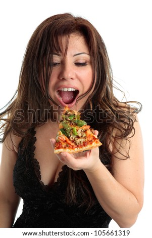 A woman eating a slice of delicious pizza. - stock photo