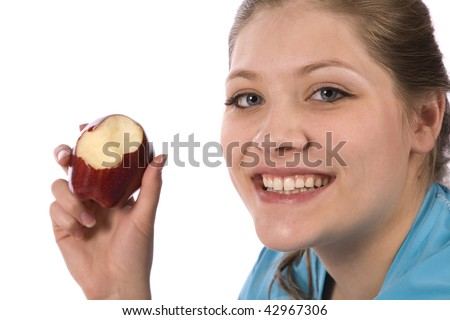 A woman eating healthy by biting into a big red apple. - stock photo