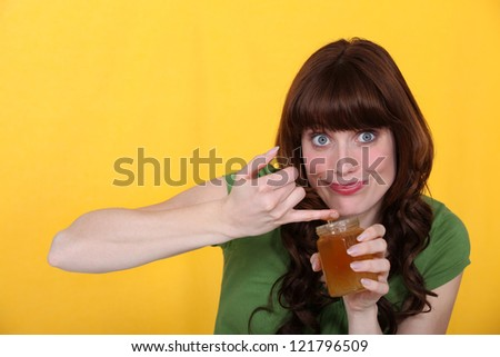 a woman eating jam - stock photo