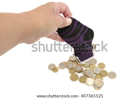 A woman empties her sock which is filled with coins - stock photo