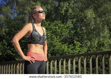 A woman enjoying the sun - stock photo