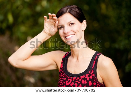 A woman exercising in a park, taking a break - stock photo
