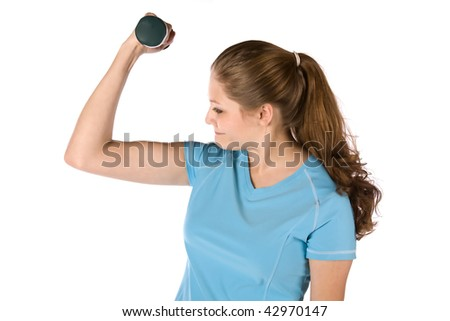 A woman exercising with a dumb bell looking at her arm with a sad look on her face. - stock photo