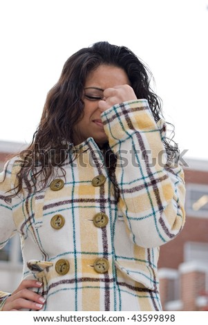 A woman experiencing a painful headache or she could be stressed out. - stock photo