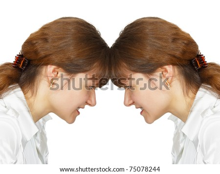 A woman facing her forehead with herself isolated on white background - stock photo