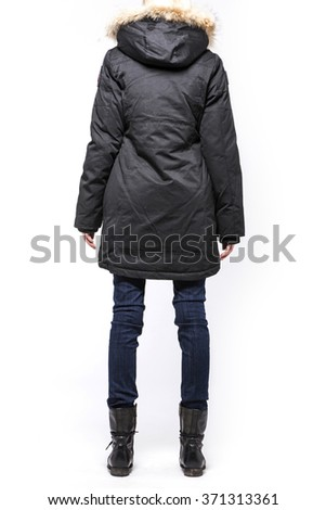 A woman(female, girl, model) wearing black jumper, blue pants(jeans, denim, trousers), brown boots(walker) for winter close up isolated white at the studio. - stock photo