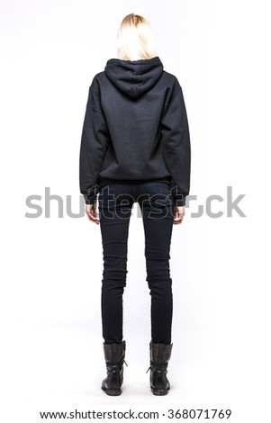 A woman(female, girl, model) wearing black sweater(shirts, top), black pants(jeans, denim, trousers), brown boots(walker) close up isolated white at the studio. - stock photo