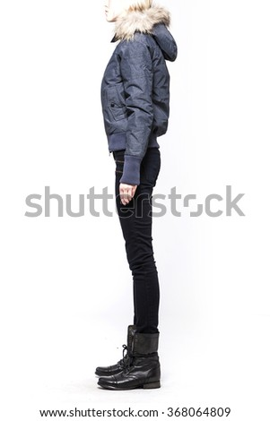 A woman(female, girl, model) wearing grey jumper, blue pants(jeans, denim, trousers), brown boots(walker) for winter close up isolated white at the studio. - stock photo