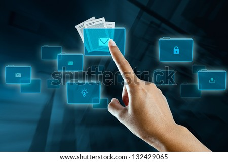 a woman finger in selection a folder on a digital screen - stock photo