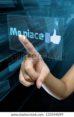 a woman finger select and like  on a italian language digital screen