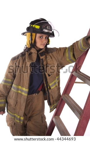 A woman firefighter in all her clothing looking serious with her arm on the ladder.