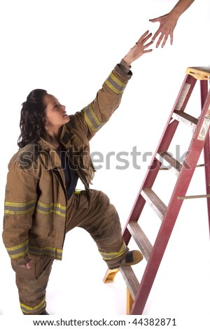 A woman firefighter reaching up a ladder to help someone. - stock photo