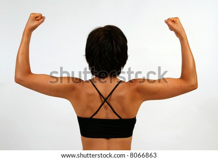 A woman flexing her biceps - stock photo