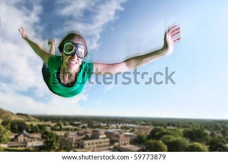 a woman flying in the air solo - stock photo