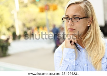 A woman gazing in thought. - stock photo