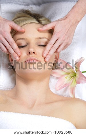 A woman gets a massage at a day spa