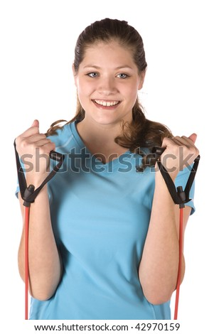 A woman getting healthy by exercising with bands with a smile on her face. - stock photo