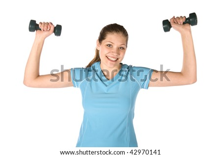 A woman getting healthy by exercising with dumb bells with a smile on her face. - stock photo