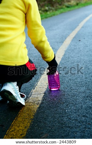 A woman getting ready for exercise and running - stock photo