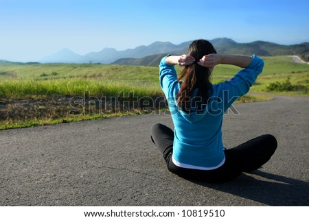 A woman getting ready to workout outdoors - stock photo