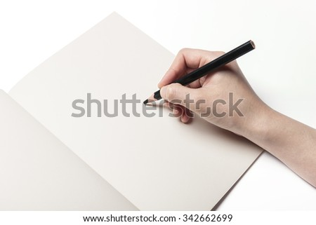 A woman(girl, female) hands hold(write) a black pencil with a empty(blank, vacant, hollow) note(diary) isolated white at the studio.
