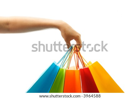 A woman hand carrying a bunch of shopping bags - stock photo