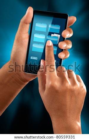 a woman hand checking folder on a mobile phone - stock photo