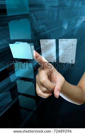 a woman hand choice a folder on a computer screen - stock photo