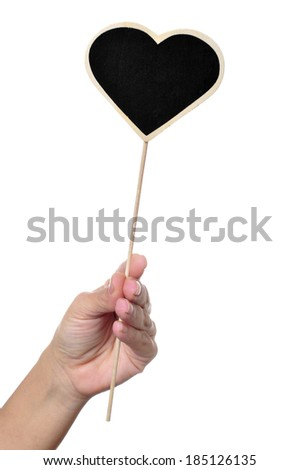 a woman hand holding a blank heart-shaped blackboard on a white background