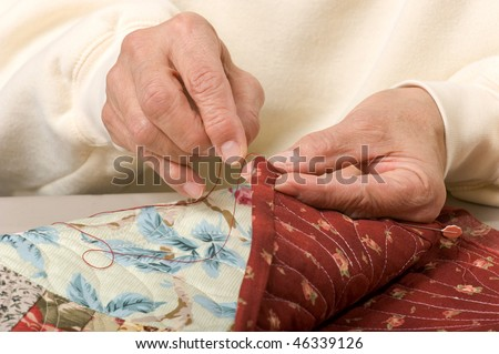 Woman Hand Sewing Binding On Quilt Stock Photo 46339126 - Shutterstock : hand sewing binding to quilt - Adamdwight.com