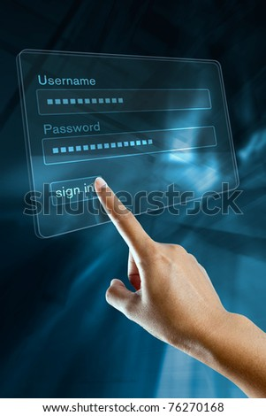 a woman hand sign in login and password on a computer screen - stock photo