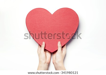A woman hands hold a empty(blank, vacant, hollow) red heart(love) gift box(container, case) and lid(cover) for holiday, christmas, thanks giving day, birthday top view isolated white at the studio.