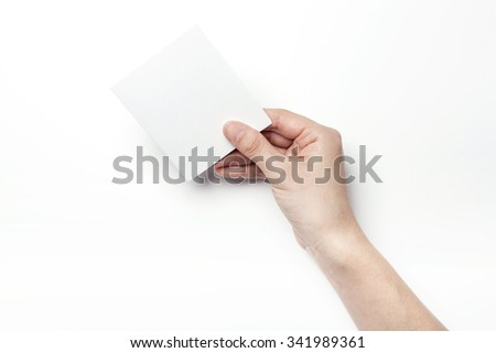 A woman hands hold a empty(blank, vacant, hollow) white paper for thank you card, letter,  postcard top view isolated white at the studio. - stock photo