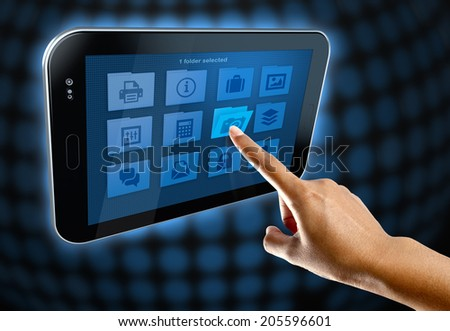 a woman hands open a folder on a tablet - stock photo