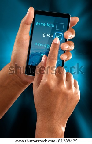 a woman hands select a option on a mobile phone - stock photo
