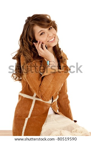 a woman happy while she is talking on her cell phone. - stock photo