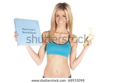 A woman has a banana and her new years resolutions. - stock photo