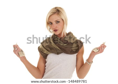A woman has two fists with money in them. - stock photo