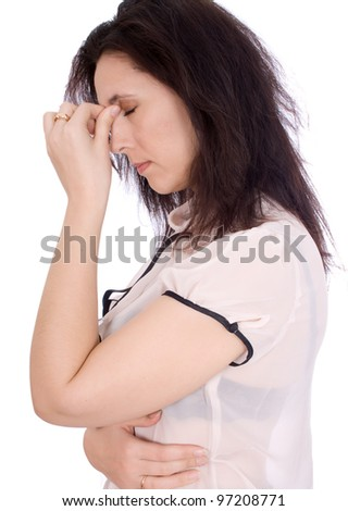 A woman having a headache, closeup isolated - stock photo