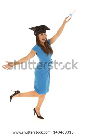 A woman having fun and showing off her excitement while holding on to her diploma. - stock photo