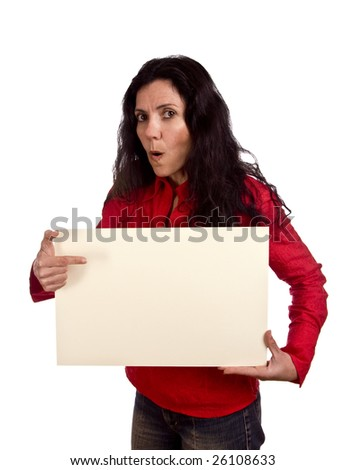 A woman holding a blank card with a suprised look